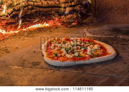 Margherita pizza in a wood oven