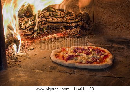Sausage pizza in a wood oven