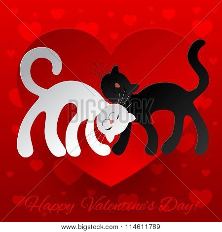Valentine greeting card with two paper white and black enamored cats against a red heart.