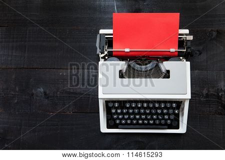 Typewriter and red paper