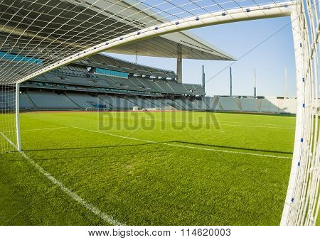 View from inside the goal in a football stadium