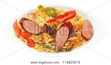 Cajun Jambalaya Voodoo Chicken and Sausage in white bowl isolated on white.