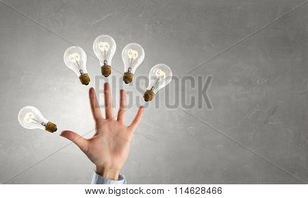 Man pointing light bulb