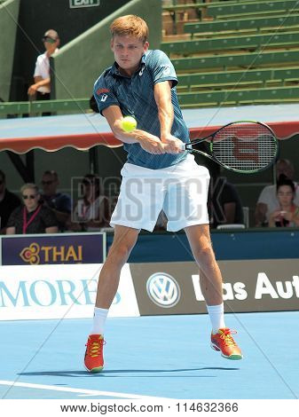 David Goffin of Belgium hits a high backhand
