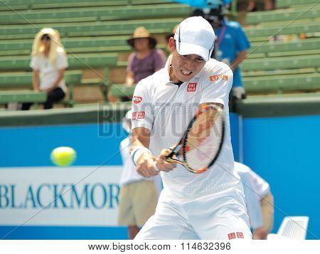 Kei Nishikori of Japan hist a mid hight backhand