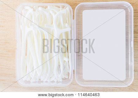 Oral Device : A box of white dental flossers on wooden background