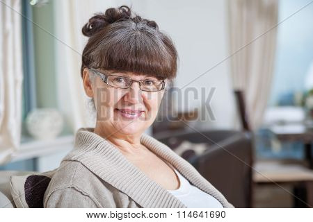 Pension age good looking woman portrait in domestic environment