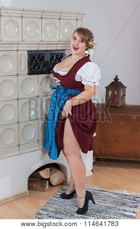 Bavarian girl with curves in dirndl