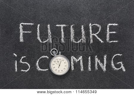 future is coming phrase handwritten on chalkboard with vintage precise stopwatch used instead of O poster