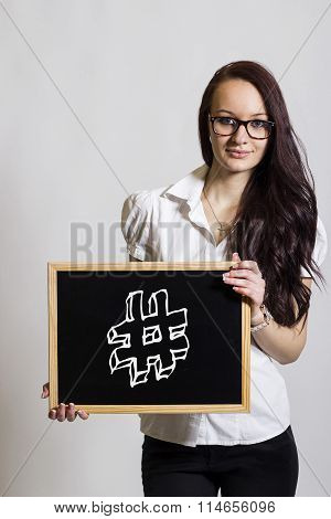 Hashmark # - Young Businesswoman Holding Chalkboard