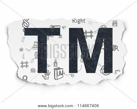 Law concept: Trademark on Torn Paper background