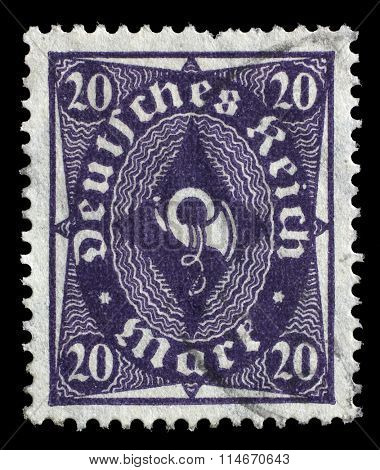 GERMANY - CIRCA 1922: A stamp printed in Germany shows a posthorn, circa 1922.