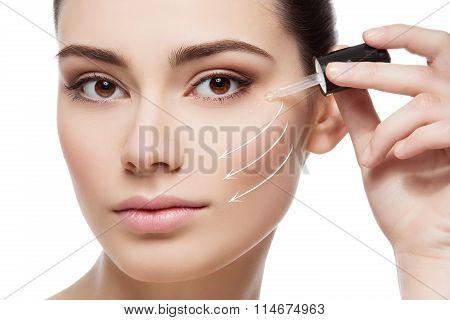 Girl applying anti wrinkle serum