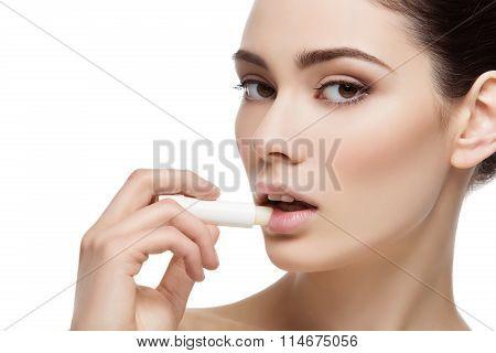 Beautiful girl applying chapstick