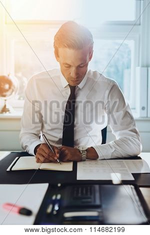 White Male Executive Working At Office