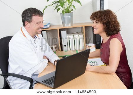 Happy Medical Rep In A Meeting With A Confident Doctor