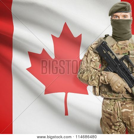 Soldier Holding Machine Gun With Flag On Background Series - Canada