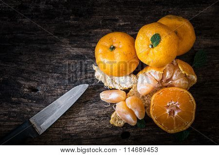 Still Life Oranges Fruit And Knife On Texture Wood.