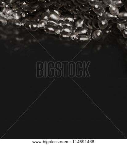 A rich, silver white pearl, luxury styles, on black background with reflection