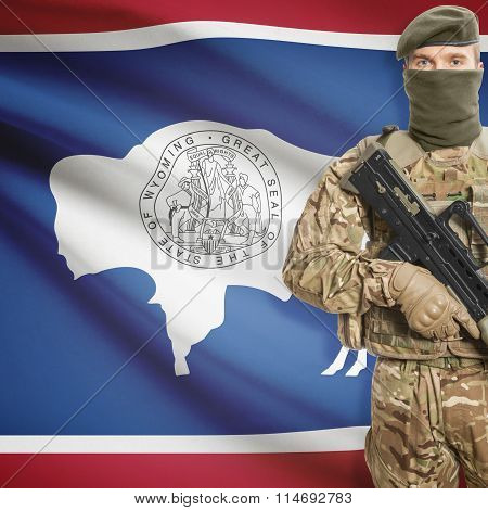 Soldier Holding Machine Gun With Usa State Flag On Background Series - Wyoming