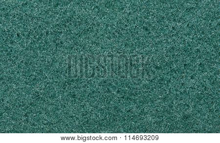 Green, fibrous texture of the fabric. Tissue texture. Closeup