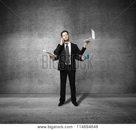 Businessman With Four Hands