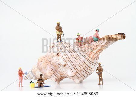 miniatures of sunbathers with a big hermit crab shell