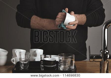 Barista Dries Coffee Cups With Microfiber Cloth