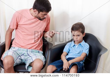 Father Scolding Unhappy Child In The Room