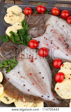 Raw Turbot Fish And Potatoes