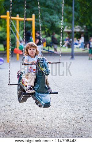 Kid On A Carousel Horse