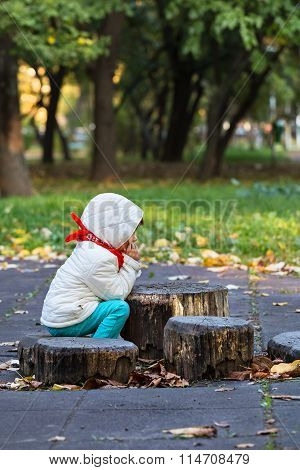 Little Child Thinking In The Park