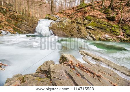 Frozen Waterfall In Forest