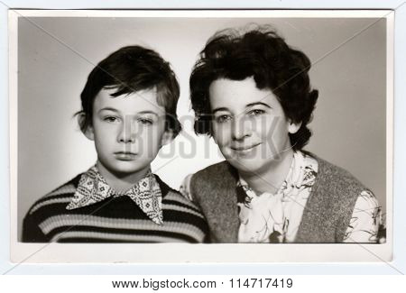 Retro photo of mother and her son. Portrait photo was taken in photo studio