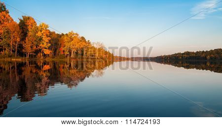 Warm September evening after a likewise day on a Northern Ontario lake as seen from a canoe.