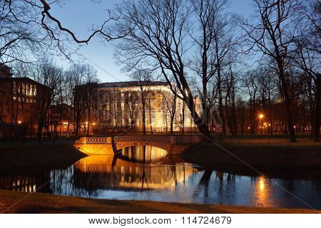ST. PETERSBURG, RUSSIA - DECEMBER 8, 2015: Night view to the pond and Mikhailovsky Palace in the Mikhailovsky Garden. Built in 1819-1825, the palace houses the Russian Museum since 1895