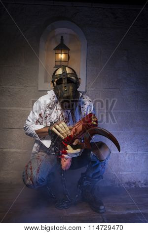 halloween costume, Man chained with blood and knife, has a severed leg blood