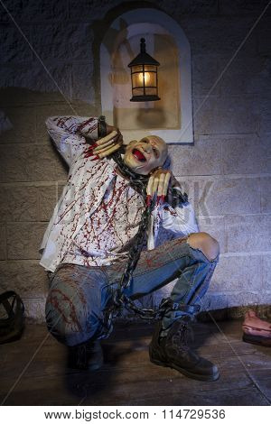 psycho, Man chained with blood and knife, has a severed leg blood