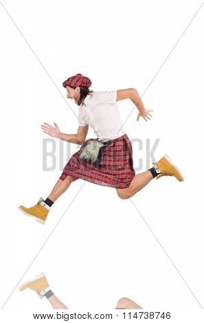 The running Scotsman isolated on white
