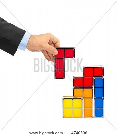 Hand with tetris toy blocks isolated on white background