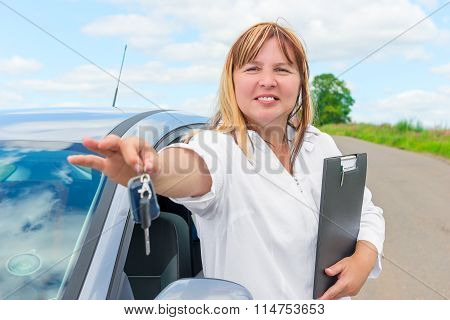 Female 50 Years, With The Keys To A New Car Is Happy