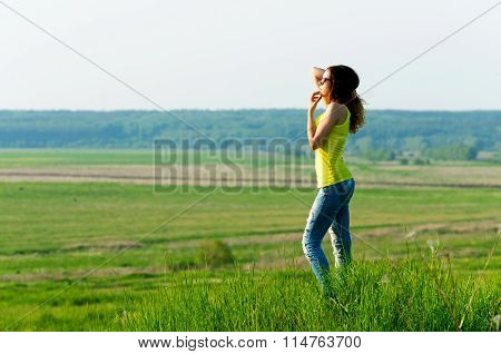 Woman looks into the distance outdoors