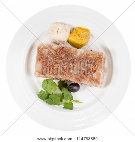 Top View Of Portion Of Meat Aspic On White Plate