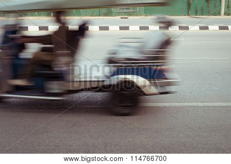 Car Fast Motion Blurred Driving On Road