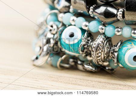 Woman Bracelet On Wooden Background