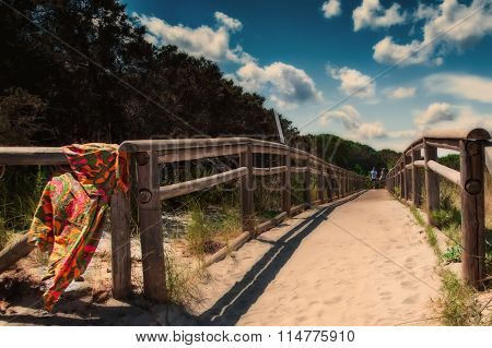 caprera sardinia Old wooden bridge on the sea beach