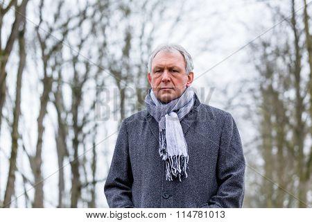 Depressed or sad man walking in winter