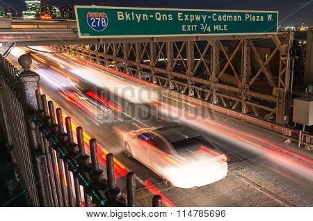Cars Speeding On The Brooklyn Bridge From Manhattan To Brooklyn in New York City