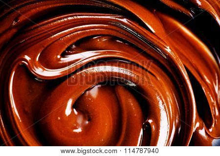Chocolate. Melted chocolate background with abstract swirls