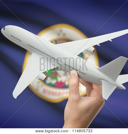 Airplane In Hand With Us State Flag On Background - Minnesota